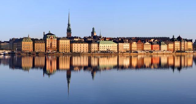 scandinavia buildings reflection on water